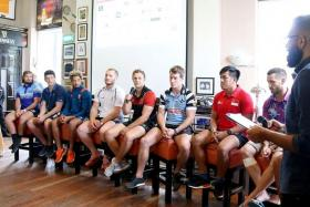 CAPTAINS' CONVENTION: Above, skippers of some of the teams taking part in the Singapore Cricket Club International Rugby Sevens take questions ahead of the tournament.
