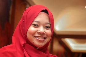 FOCUSED: Madam Nur Faezah Abdul Rahman, a teacher at Cerebral Palsy Alliance Singapore School, has never thought of teaching in a mainstream school.