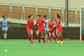 TOP OF THEIR GROUP: China (in red) will aim for a repeat in the final after beating India last night.