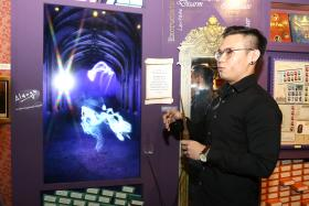 FOR POTTERHEADS: Nanyang Polytechnic student Low Yao Ming was part of the team that worked on the interactive multimedia features at the exhibition (above).