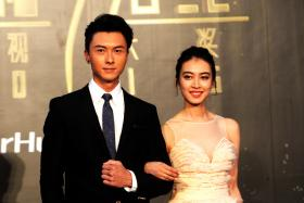 TVB actress Tracy Chu (right) juggles law school and acting, and appeared on the red carpet of the StarHub TVB Awards 2016 with actor Vincent Wong (left).