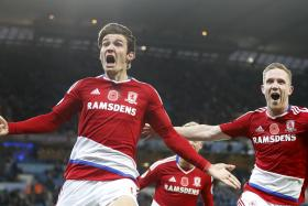 DRAMATIC EQUALISER: Marten de Roon's (left) late header gives Middlesbrough a point against Manchester City.