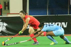FITTING FINALE: India (in blue) overcoming China to win the Women's Asian Champions Trophy last night.