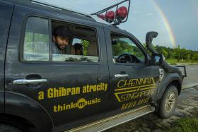 ON THE ROAD: Director Abbas Akbar in the Ford Endeavor SUV used in his road trip from Chennai to Singapore.