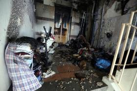 CHARRED REMAINS: Piles of discarded items at a lift landing of Block 59, Lengkok Bahru are believed to have caused the fire yesterday morning.