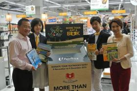 PROUD: Mr Seah Kian Peng (left) and Ms Low Yen Ling (right) with students from Hougang Secondary School.