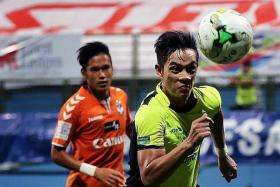 CHASING THE CARROT: The FAS has a big task to revive interest in the S.League, where teams like Tampines Rovers (above, in green) ply their trade.