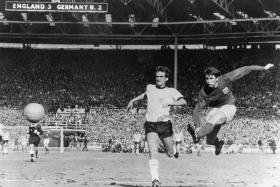 HERO: Geoff Hurst (right) scoring England's fourth goal to complete a historic hat-trick.