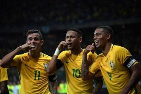 BARCA CALLING? (From left) Philippe Coutinho, Neymar and Gabriel Jesus celebrating after Coutinho scored a long-range opener.