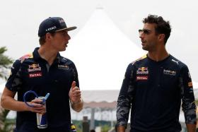 THEIR APPROACH: Red Bull drivers Max Verstappen (left) and Daniel Ricciardo (right) won't be treating the final rounds any differently from the rest of the year.