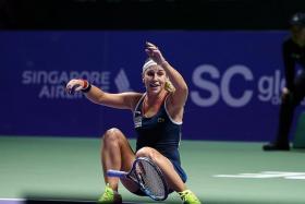 POCKET ROCKET: World No. 5 Dominika Cibulkova's (above) victory at the WTA Finals last month serves as an inspiration to female athletes.