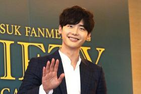 CHARMING: South Korean actor and model Lee Jong Suk (right) charmed fans in Singapore with games and songs.