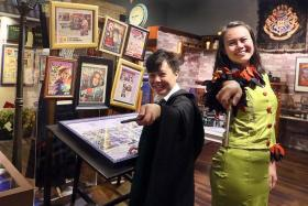 LOOKING MAGICAL:Harry Potter fans Chin Xuan (left) in a Hogwarts Slytherin house uniform and Jo Chua (right) in a handmade Rita Skeeter costume.