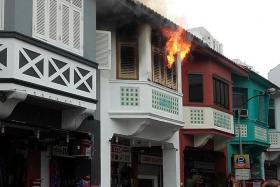 CONCERNED: Mr Michael Nassim, owner of Emri Electronics, whose shophouse was damaged after the fire spread to his unit. FIRE: A fire at a shophouse on Roberts Lane later spread to a neighbouring unit.