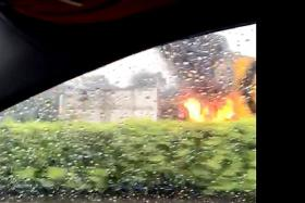 ON FIRE: (Above) Mr Roslan Samsuri suspected something was wrong with the lorry's tyres as he drove past it on the Pan Island Expressway.