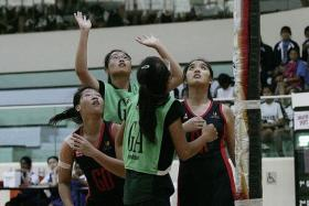 Greenview Secondary School and Singapore Sports School face-off in the Schools National Netball Championship.