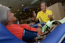 SHOCKED: Dialysis patient Joseph Chan (right) broke down in tears when he heard the news of Mr Edmund Kwok's sacking.