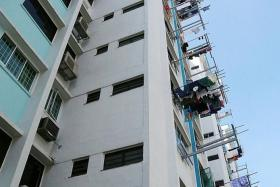 DIED: Mr Ong Chai Seng was found dead at the foot of this block. His wife, Madam Koh Eng, had head injuries.