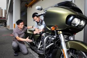 LOWER TEMPS: Harley-Davidson Singapore sales manager Willy Low explaining the secret behind the 2017 Road Glide Special's cooler engine