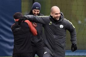 FUN TIME: Manchester City manager Pep Guardiola (right) in a relaxed mood at training with his team.