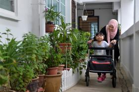 DETERMINED: There is no cure for Hereditary Spastic Paraplegia, but Qatrina Yusri walks to strengthen her legs.