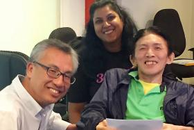 BIM Studio Manager Timothy Ang, 61, (right), received a cheque on behalf of the Disabled People's Association from Mr Yong Fook Chyi, director (corporate services) of Tote Board. Looking on is 