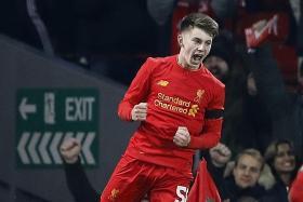 Woodburn a new Reds hero