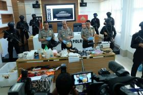 Indonesian police spokesman Inspector General Boy Rafli Amar (centre) reveals details of the latest terror cell, including their military-grade explosives. PHOTO: THE STRAITS TIMES