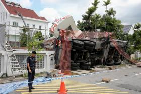 Two houses damaged by crane in Siglap