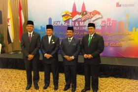 (From left) Minister-in-charge of Muslim Affairs Yaacob Ibrahim, Brunei Religious Minister Awang Badaruddin Awang Othman, Malaysia's Minister in the Prime Minister's Office Major-General Jamil Khir Baharom, and Indonesian Religious Minister Lukman Hakim Saifuddin.