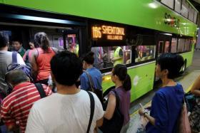 Passengers boarding the Tower Transit bus service 106 at Bukit Batok Bus Interchange.