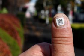 These tiny nail stickers each carry a unique identity number to help concerned families find missing loved ones.