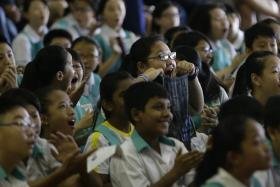 Pupils at Zhonghua Primary School when the school's overall PSLE results were revealed on 24 November 2016.
