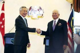 Singapore and Malaysia signed a legally binding bilateral agreement to build a high-speed rail line that is targeted to start operating by Dec 31, 2026.