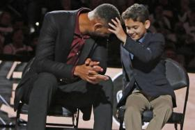 An emotional Tim Duncan is comforted by his son.