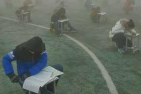 An outcry ensued after students in China's Henan province sat for their exams outdoors during heavy smog, which is not uncommon in the country.