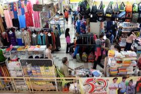 Shoppers in Johor Bahru.