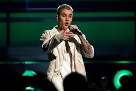 Bieber to face trial for assault