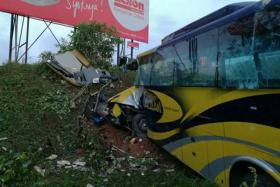 A Kuala Lumpur-bound express coach from Johor Baru crashed into a ravine on the North-South Expressway near Muar, Johor, in the early hours of Saturday, killing 14 people, including three Singaporeans and a Singapore permanent resident.