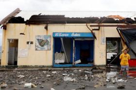Typhoon Nock-Ten kills 4 in Philippines, threatens Manila