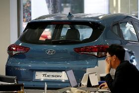 Hyundai cuts costs, looks to designing new models