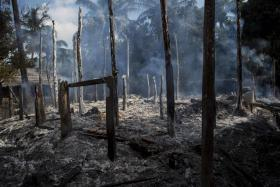 This file photo taken on October 14, 2016 shows smouldering debris of burned houses in Warpait village, a Muslim village in Maungdaw located in Rakhine State as the government announced that terror groups were behind the series of attacks