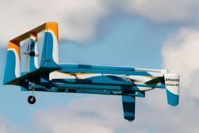 Amazon said it completed its first delivery by drone earlier this month, in what the global online giant hopes will be a trend in automated shipments by air.
