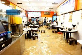 Choked drain at MRT work site caused flash floods