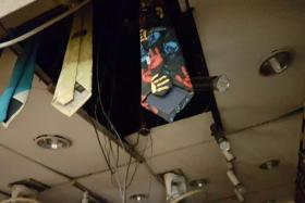 (Above) At Isrida, a tie shop down the corridor, parts of the ceiling had fallen off although the shop was not broken into.