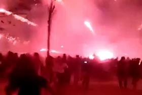 Revellers flee as fireworks display turns into 'war zone'