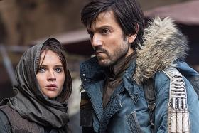Infectious music Carey shrugs off New Year's Eve glitch Rogue One keeps firm grip on box-office top spot