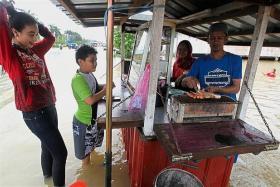 Floods ravage Malaysia
