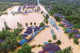 Almost 23,000 flee their homes as floods ravage north-eastern Malaysia