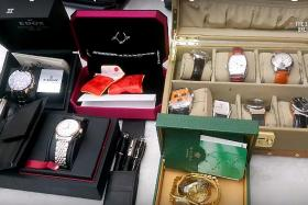 Gold bars, cash, luxury bags and watches seized